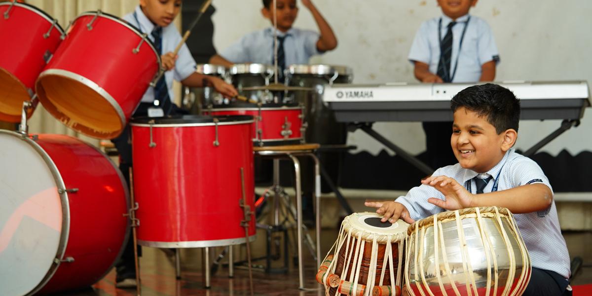 student playing tabla